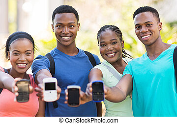 group of african college students showing smart phone -...