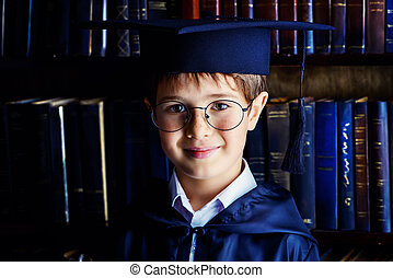 academy - Smart boy stands in the library by the bookshelves...