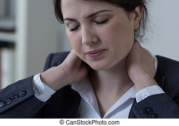 Neck pain - Female white-collar worker having neck pain