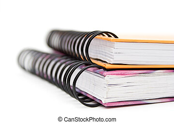Notebooks - Two colourful notebooks on white background