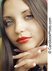 face of young beautiful brunette woman