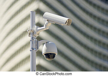 security camera - two security camera against a modern...