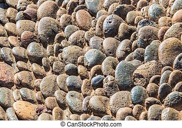 Sea stones and background stones .