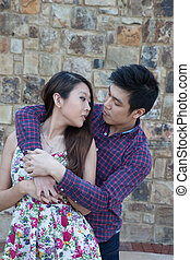 Romantic Asian couple outdoors - Romantic couple he is...