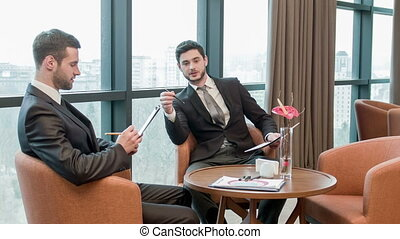 Business with colleagues in meeting room - Businessmen on...