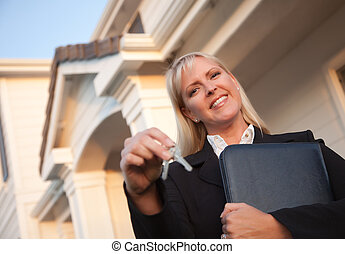 Real Estate Agent Handing Over Keys to New Home - Female...