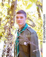 Portrait of Boy Scout in Forest on Sunny Day - Waist Up...