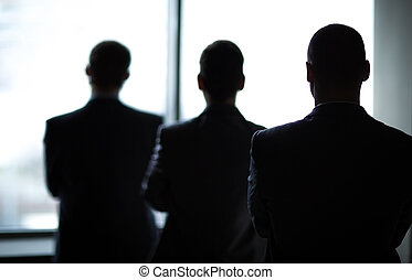 silhouette of three businessmen