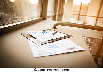 workplace of the businessman - Drawings and charts of...