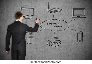 computer network - businessman drawing computer network on...