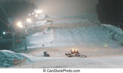 Snowcat works at the ski slopes - Rathrak tractor rides on...