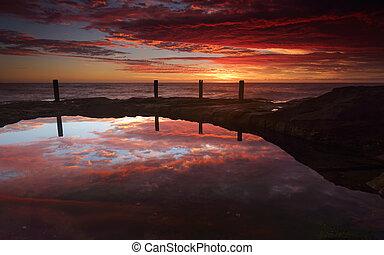 Spectacular sunrise over Ivo Rowe Rockpool Coogee Australia...