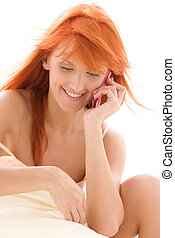happy redhead woman with cell phone