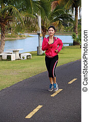 young healthy asian woman running