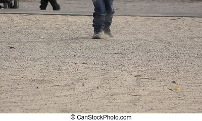Close up Little Girl Running in Boots on Sand