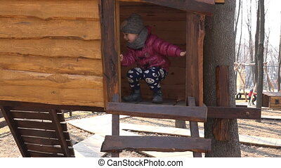 Little Girl in Wooden Playhouse