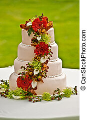 Wedding cake - A layered and flowers decorated wedding cake
