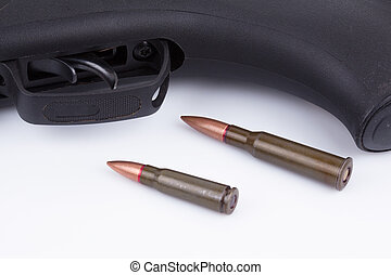 Close-up of riffle with bullets on white background