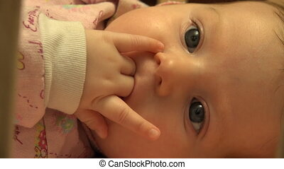 Baby Sucking Her Fingers, Closeup