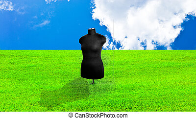 dummy - black female mannequin in the background of blue sky...