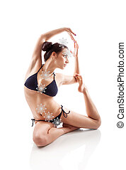 Yoga and stretching. - Sexy girl in her 20s in bikini...