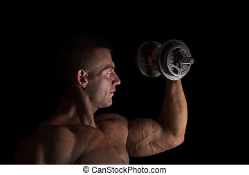Bodybuilding - Handsome bodybuilder lifting weights isolated...