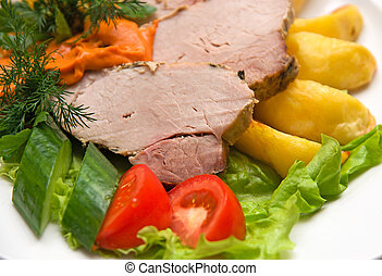 meat dish with fresh vegetables - Close op of Tasty meat...