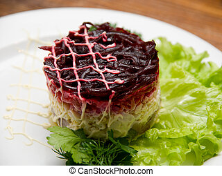 salad dish - Tasty fresh healthy salad with herring on...