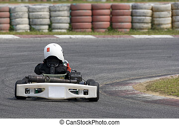 Karting Action - Image of a go-kart racer competing at the...