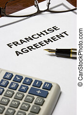 Franchise Agreement - Image of a franchise agreement on an...