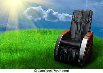 massage arm-chair on the grass field - Sunny day with...