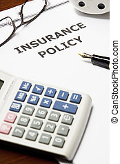 Insurance Policy - Image of an insurance policy on an office...