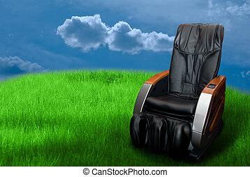 massage arm-chair on the green grass field.