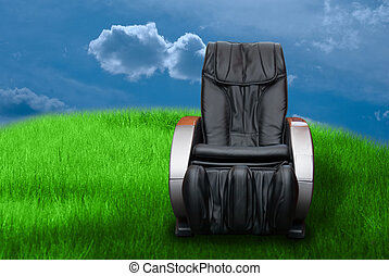 massage arm-chair on the green grass field background.