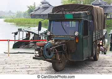 Chinese Motorised Three Wheel Transport - Image of a Chinese...
