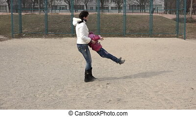 Young Mother Having Fun with her Little Daughter in Sportfield