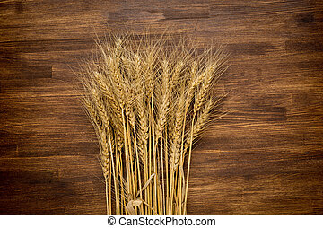 wheat on wooden background. - wheat on a wooden background....
