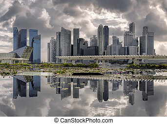 Reflections on a cloudy day - Reflections and clouds at...
