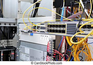 Telecommunication equipment of network cables in a datacenter of