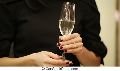 Champagne in hand - In hands woman glass of champagne on...
