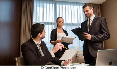 Business with colleagues in meeting room - Meeting with a...