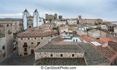 Time Lapse of Caceres down town with tourists at sunset, top...
