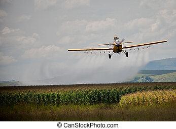 CropSprayer - Crop sprayer in action spraying chemicals on a...