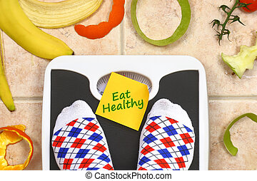 Feet on bathroom scale with Eat Healthy text fruit peals...