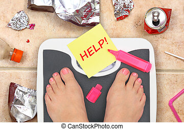 Feet on bathroom scale with word Help and junk food garbage