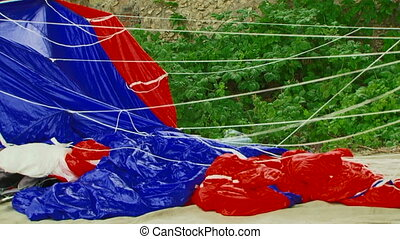 Cloth Of Blue And Red Parachute Swaying On Breeze -...