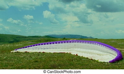 White And Purple Parachute Lying On The Ground - In the...