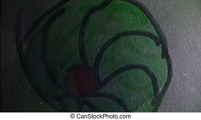 graffiti green  circle ornament night light moves along the wall abstract background pattern