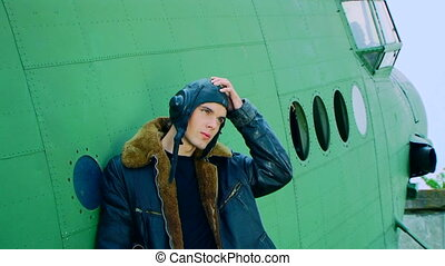 Man Standing Near Plane Taking Off Flight Helmet - Portrait...