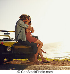 Romantic young couple on road trip - Young couple in love...